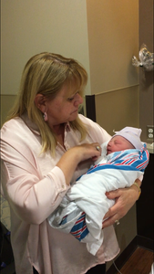 Grandma holds baby for first time