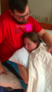 Husband helps relax mom during late labor
