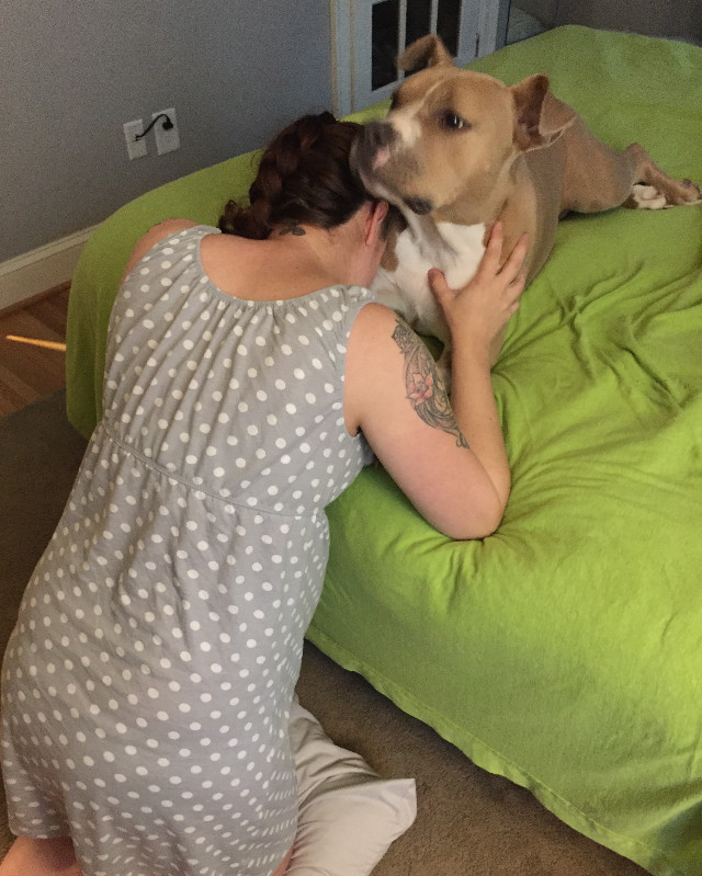 Dog offers support to mom laboring at home