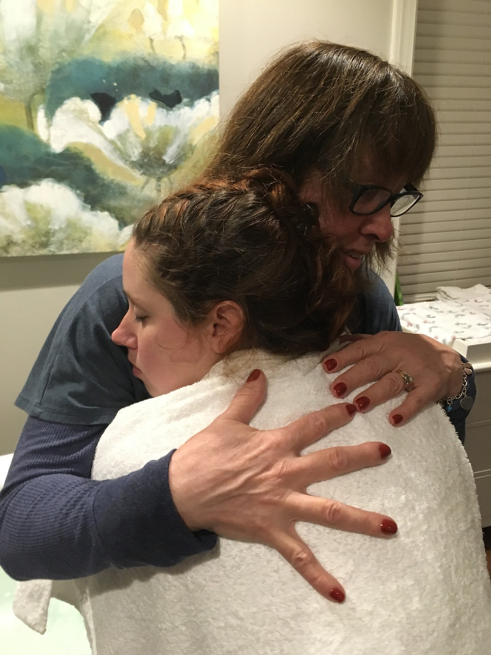 Doula embraces laboring mom during contraction