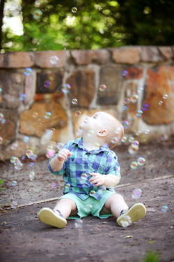 Baby Looking At Bubbles