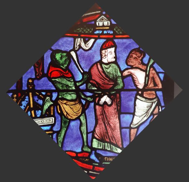 Démon de couleur verte sur les vitraux de la cathédrale de Chartres (vers 1215)