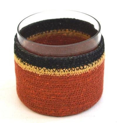 Glass votive with tan & black basket
