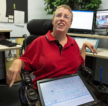 Click here to read Tracy's story. Image of Tracy at work shown.