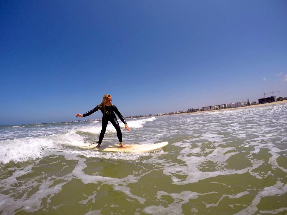 Surfer girl Essaouira Morocco