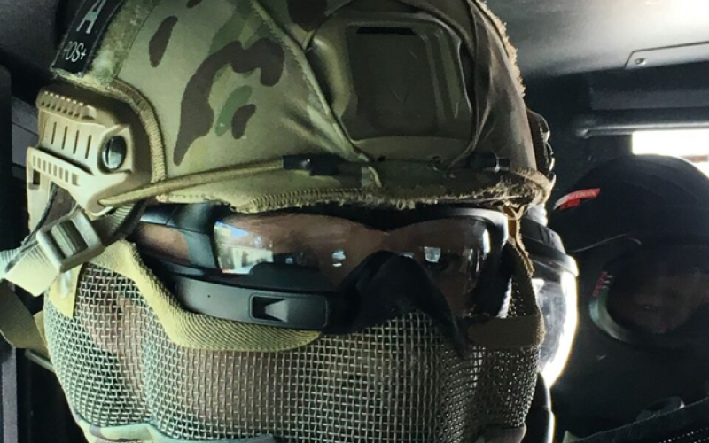 A police SWAT team member gears up to test augmented reality glasses during Urban Shield, an annual first responder exercise and weapons exhibition in Northern California. The smart eyewear, a creation of Mutualink and Intel's Recon Jet, provide situational awareness to users via information transmitted to the corner of the glasses.