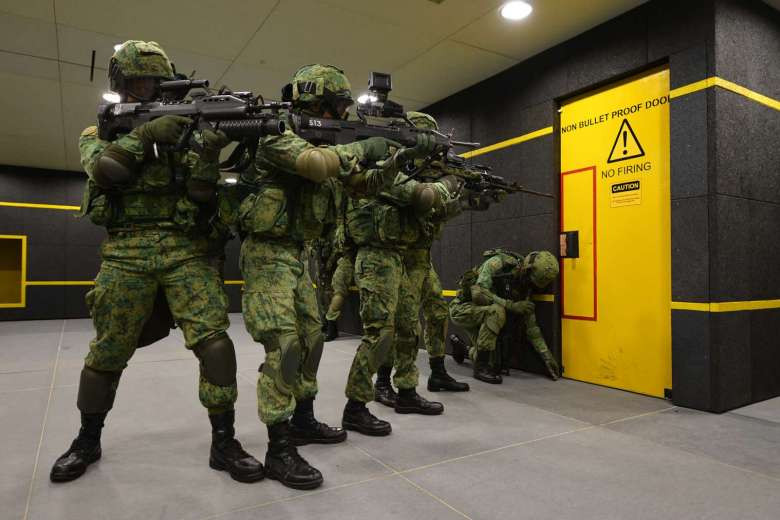 NS men in action at the SAF Multi-Mission Range Complex - a first of its kind three-storey indoor live firing range located at Pasir Laba.PHOTO: ST FILE
