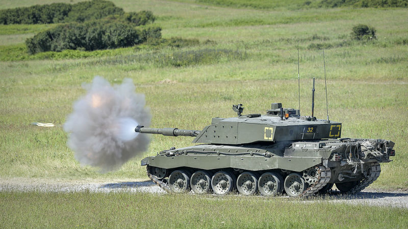 A Challenger 2 tank on Castlemartin Ranges in Pembrokeshire, Wales fires a 'Squash-Head' practice round. MoD Open Gov licence.