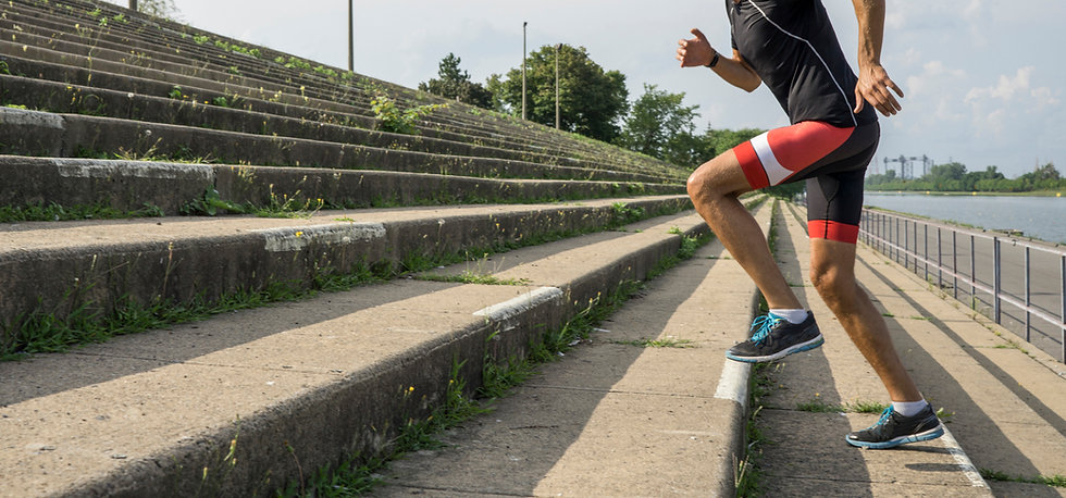 man running up steps