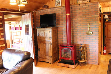 Traverse City cabin rental - living room and Vermont Castings stove
