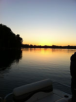 Traverse City cabin rental - view of Silver Lake sunset on the water