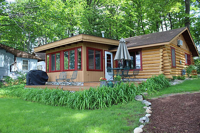 Traverse City cabin rental - view of cabin and campfire pit from the water