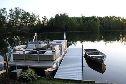 Traverse City cabin rental - view of lake and pontoon boat