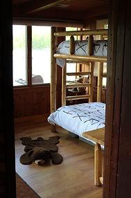 Traverse City cabin rental - log bunk beds