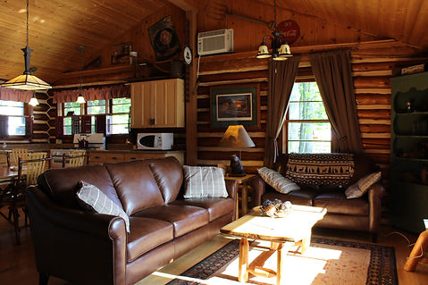 Traverse City cabin rental - living room with large window overlooking the lake