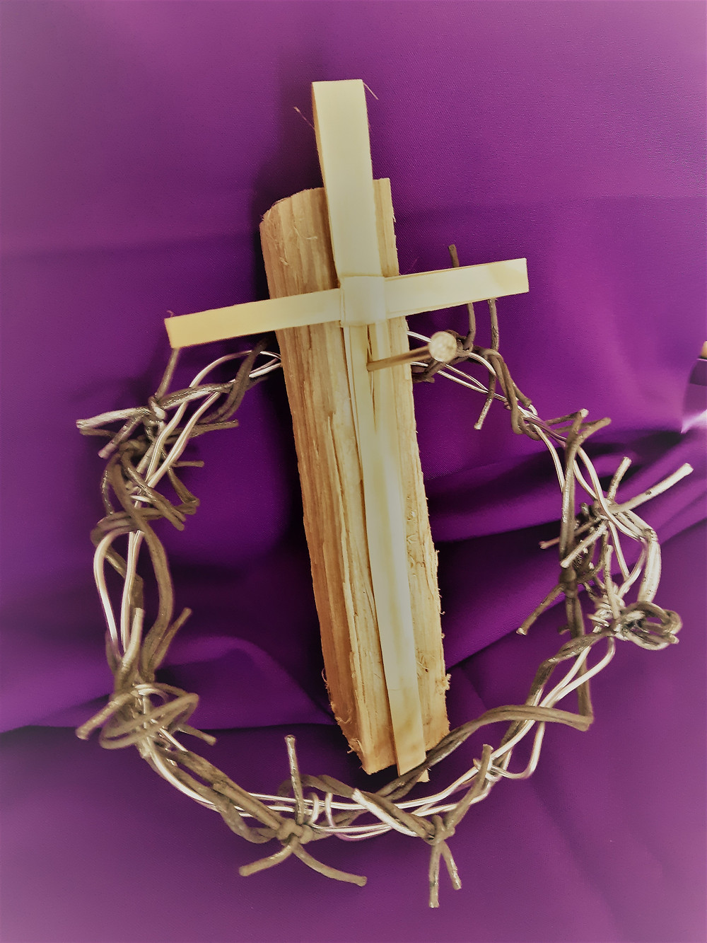 Palm cross with crown of thorns, nail and piece of wood
