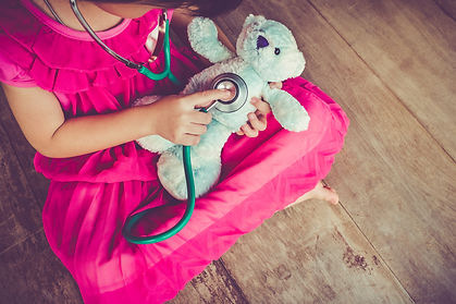 Top view of child playing doctor or nurs