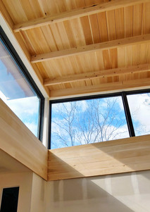 Clerestory windows at lifted living room ceiling.