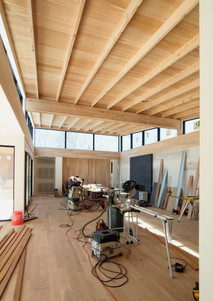 Wood beams and joists at lifted Great Room ceiling.