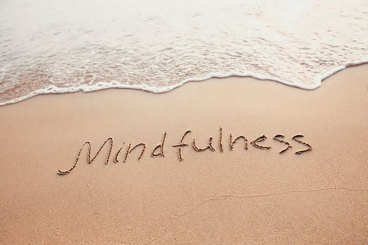 mindfulness concept, mindful living, text written on the sand of beach.jpg