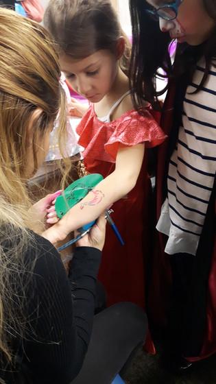 Artist-Tattooing-Little-Girl-On-Hand.jpg