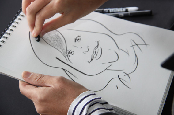 Caricaturist-Woman's-Drawing.JPG