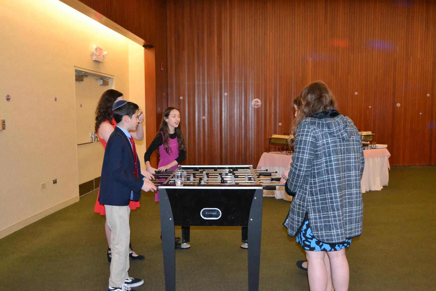 Kids-Playing-Foosball-Table-Game.JPG