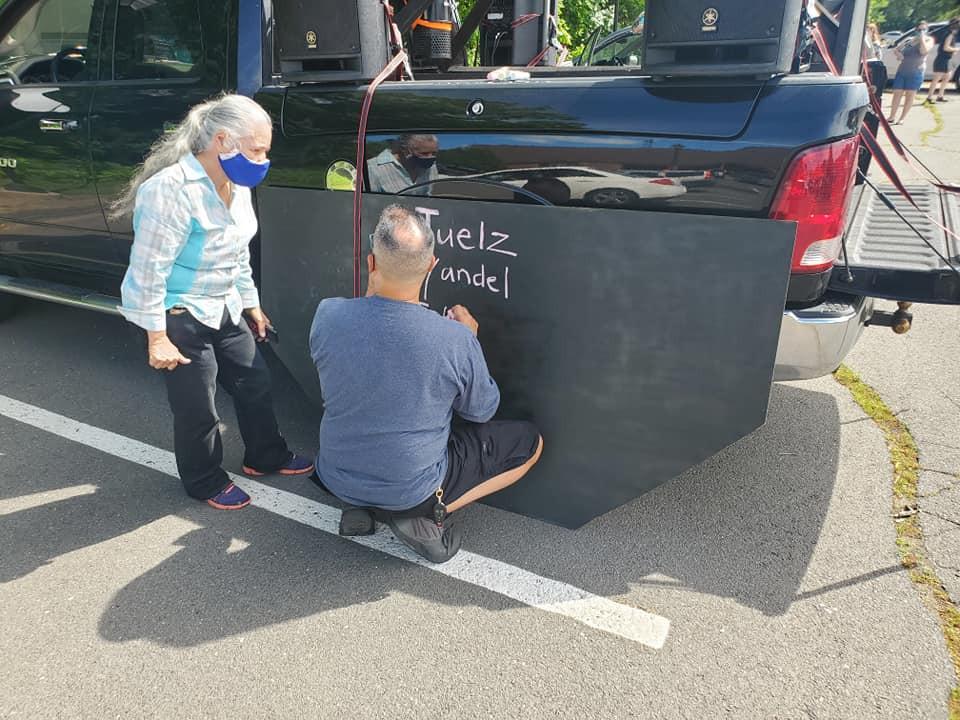 Old-Man-Writting-Dedication-At-The-Board