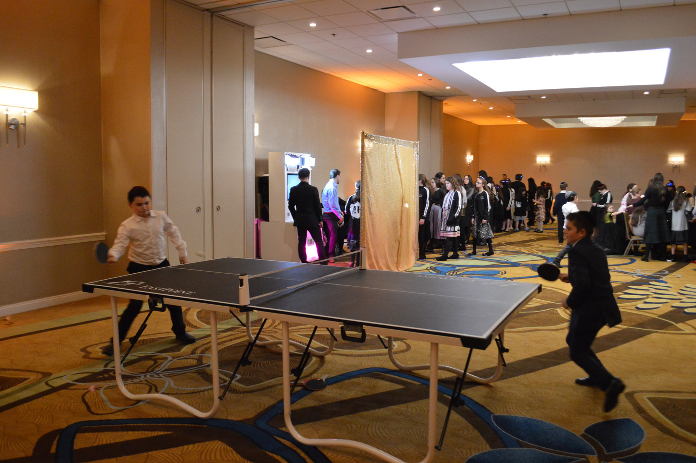 Two-Boys-Plays-Table-Tennis-Game.JPG