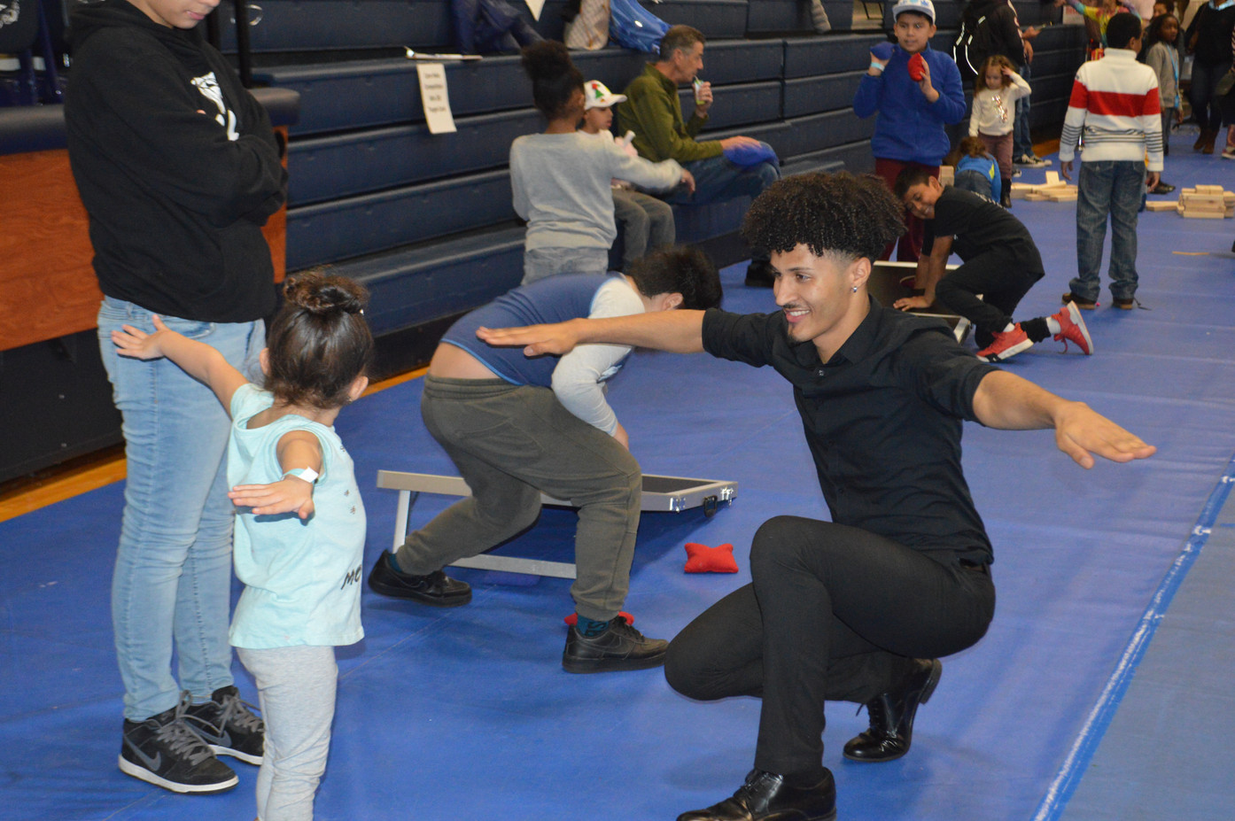 Motivational-Dancer-Teaches-With-Kid.JPG