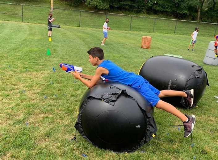 Boy-On-Inflatable-Obstacle-At-Nerf-War.jpg