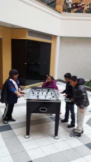 Four-Kids-Plays-Table-Football.jpg