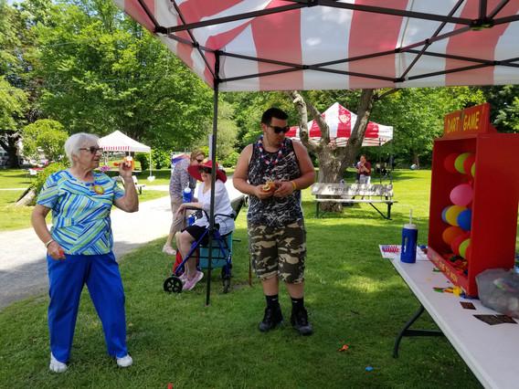 Adult-Woman-Playing-Balloon-Dart-Game.jpg