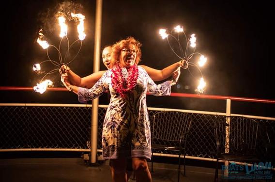 Fire-Show-Artist-Teaching-Old-Woman.jpg