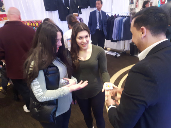 Magician-With-Two-Ladies-At-Mall-Trade-Show.jpg