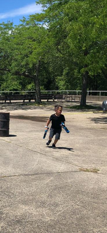 Little-Boy-With-Nerf-Gun-In-Both-Hands.jpg