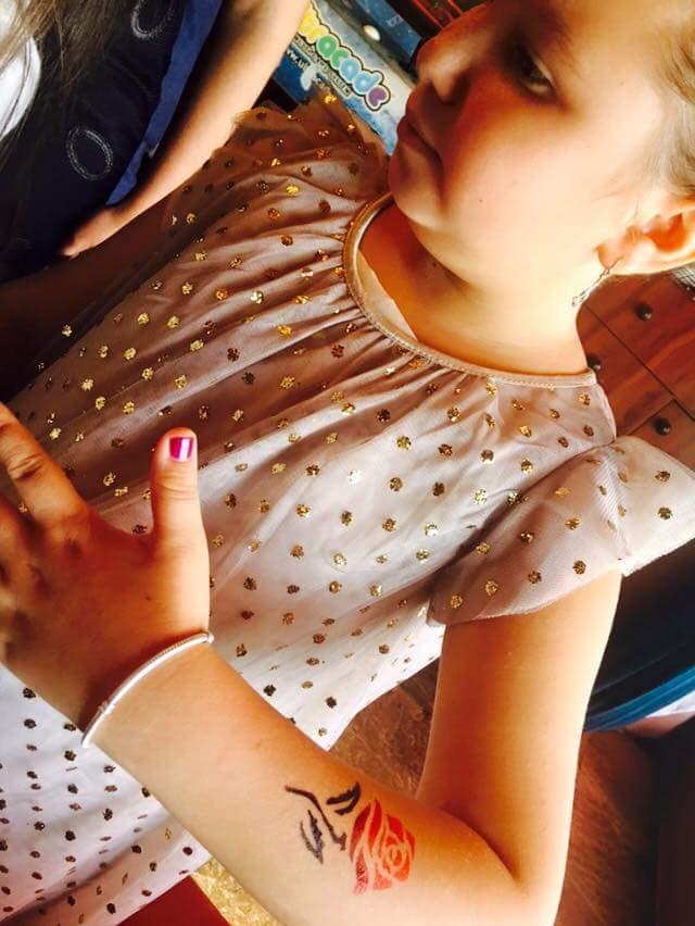 Little-Girl-Airbrush-Flower-Tattoo-On-Hand.jpg