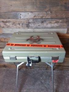 Biohazard-Box-Game-Closed-On-Stand.jpg