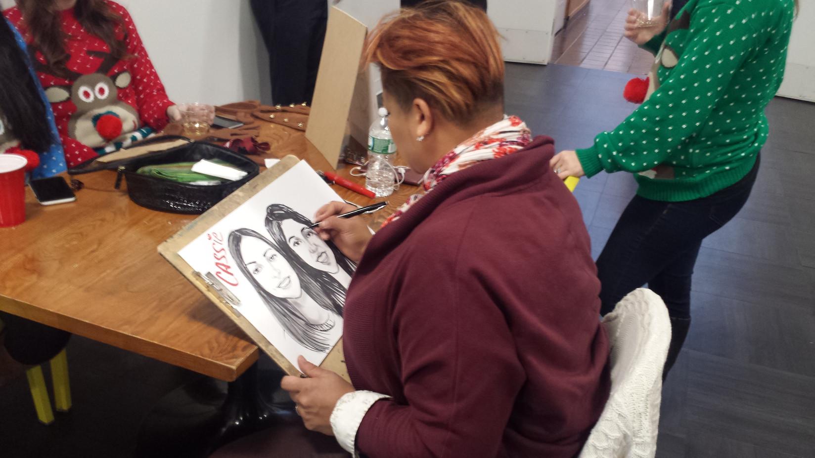 Cartoonist-Draws-Two-Ladies-Working-On-Progress.jpg