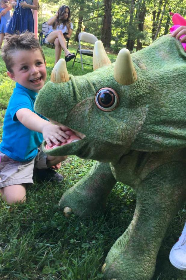 Animatronic-Dinosaur-With-Little-Boy.png