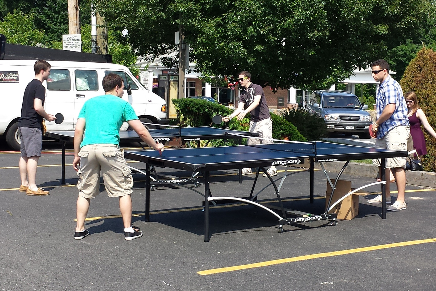 Two-Pairs-Of-Man-Playing-Table-Tennis-No-Contact-Game.jpg