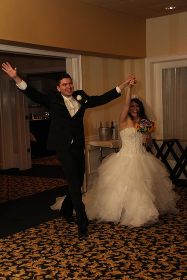 Bride-And-Groom-Entering-At-The-Reception.JPG