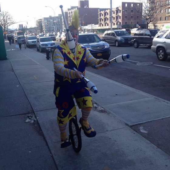 Clown-Juggler-On-Unicycle.jpg