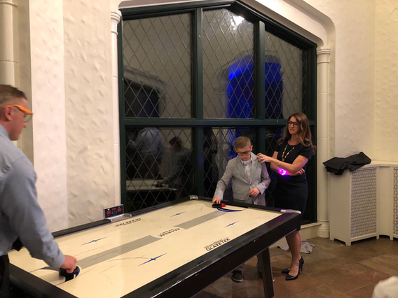 Air-Hockey-Game-Playing-By-Father-And-Son.png