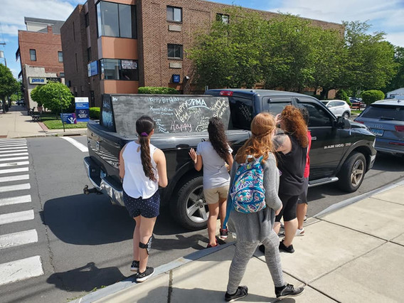 Three-Ladies-Going-To-Mobile-Car-For-Mobile-Caravan.jpg