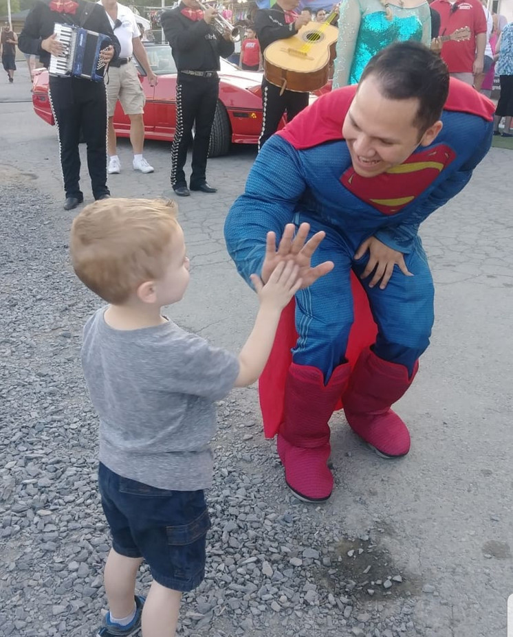 Super-Man-Costume-Character-With-Little-Boy.jpg