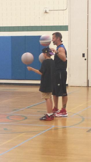 Basketball-Trick-Performer-Teaching-A-Boy.jpg