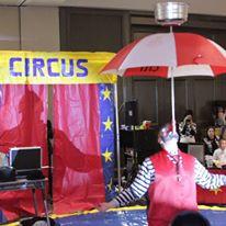 Circus-Umbrella-Balancing-Using-Using-Chin.jpg