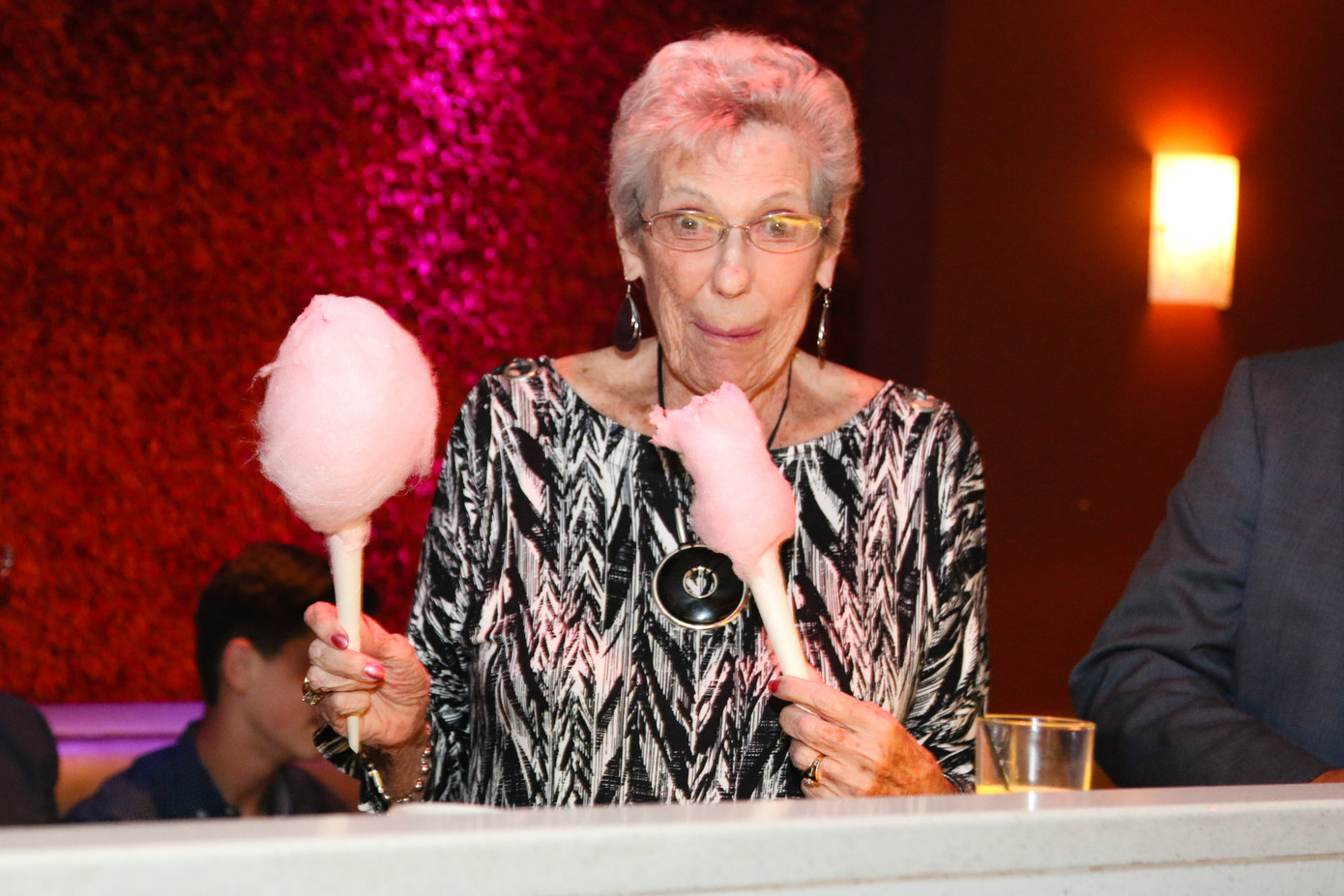 Adult-Woman-Eating-Cotton-Candy.jpg
