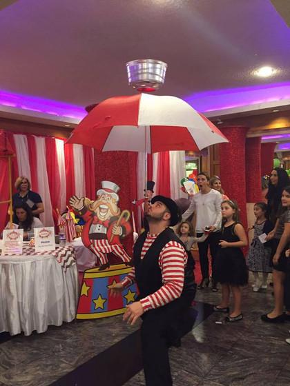 Umbrella-Balancing-Using-Chin-At-Kids-Party.jpg